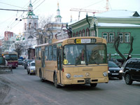 Ex-western second-hand private bus at Lenina Ul. and Dzerzhinskogo Ul.
